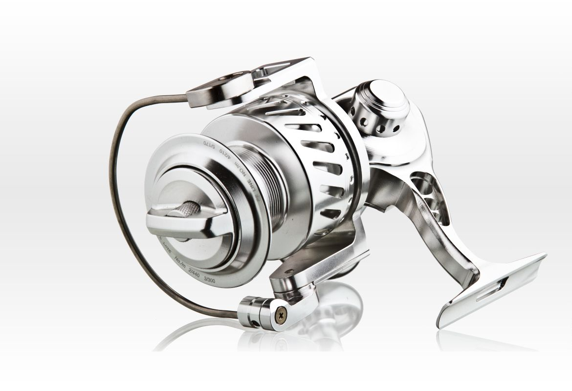 Metal on white photography Fishing reel Commercial Photographyand custom product photography